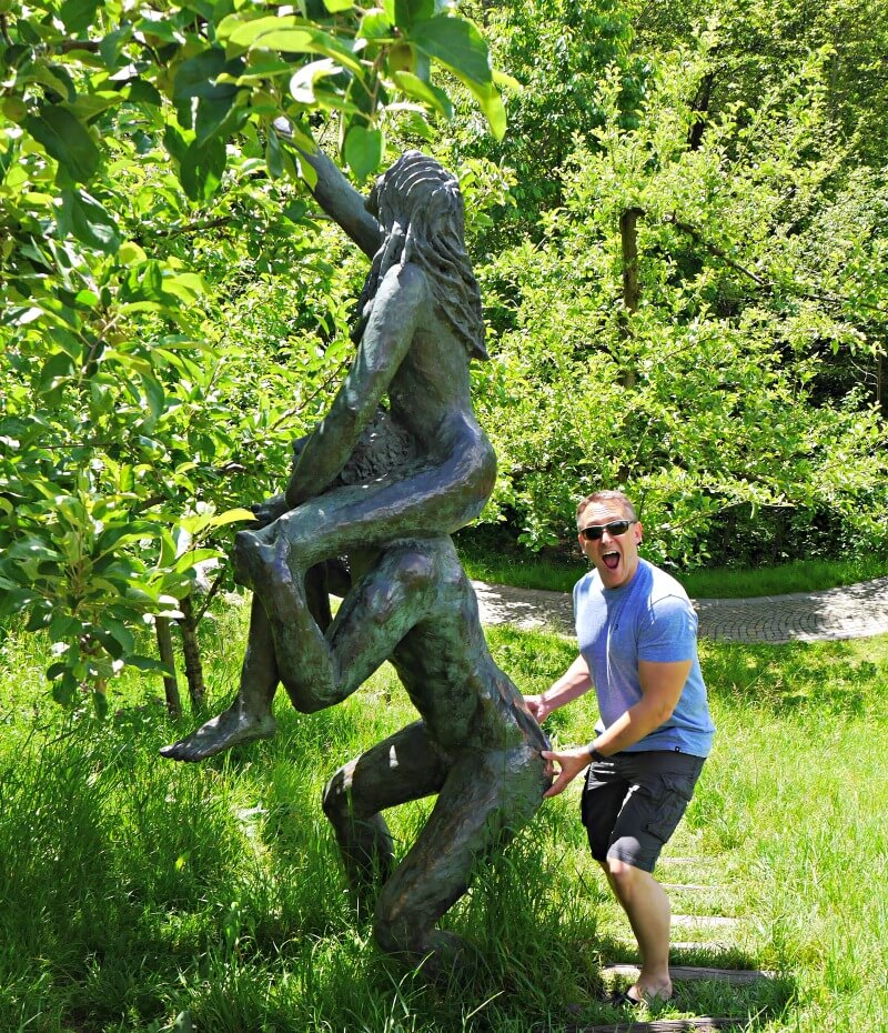 Adam and Eve picking an apple at the gardens