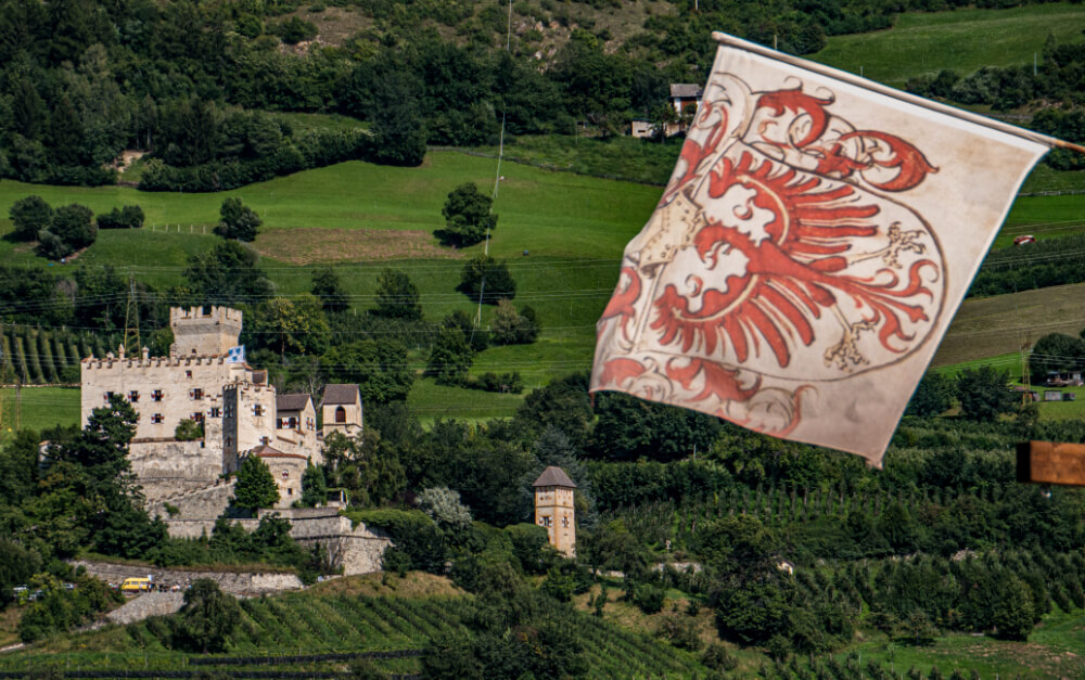 Churburg Castle with the flag of South Tyrol