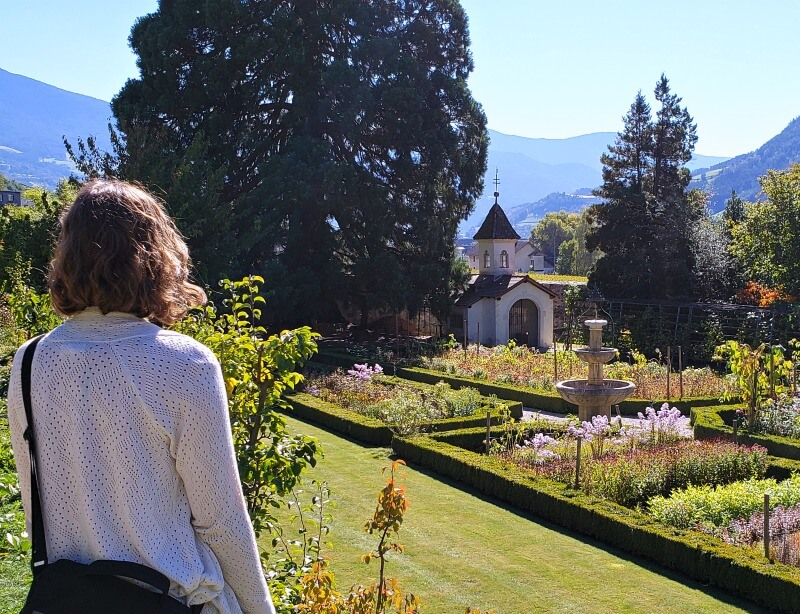 Admiring the historic Abbey of Novacella garden (also known as Neustift Monastery)