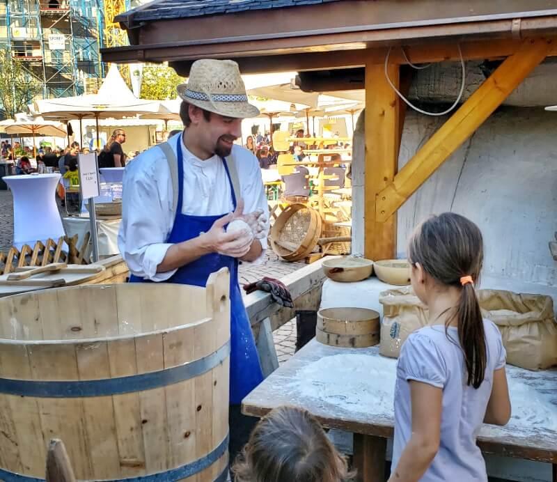 Demonstrating making dough in Brixen