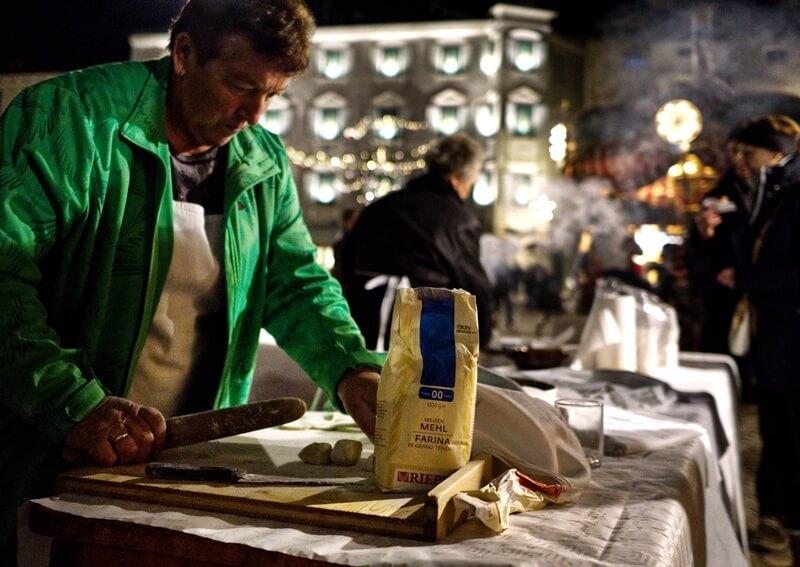 A lady making krapfen in Brixen