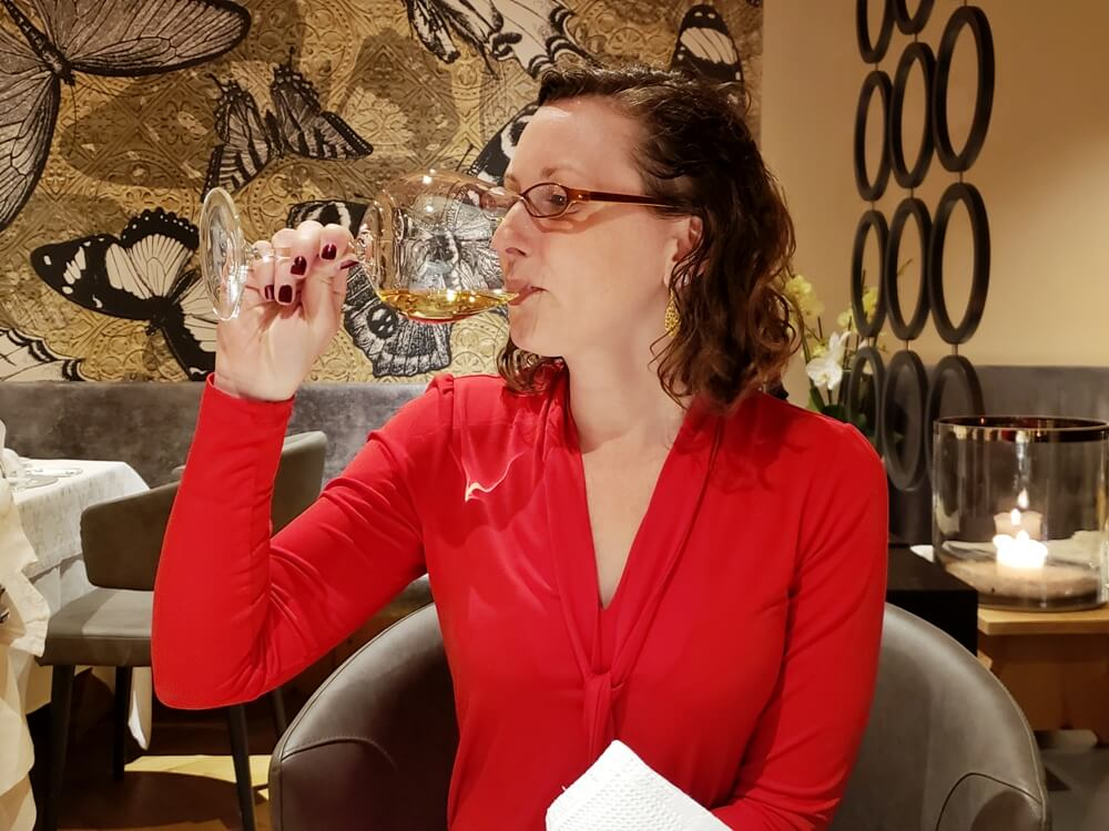 Kate Sipping Elena Walch Wine