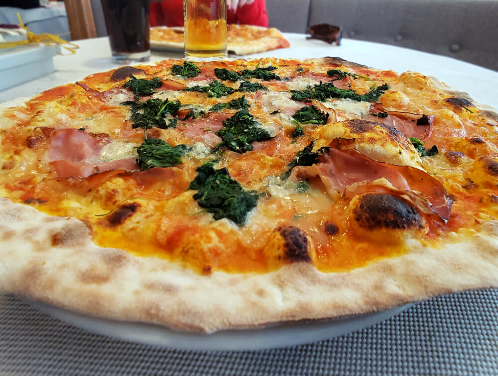 Pizza with Speck in South Tyrol